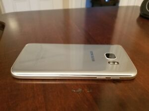 Unlocked silver Samsung S7 with battery case