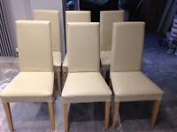 Six cream leather dining chairs