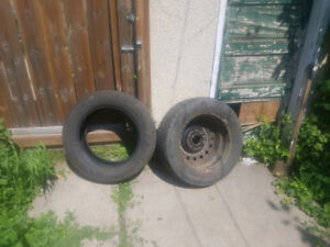 2 Great Condition Tires, one with rim. 205/60/R16