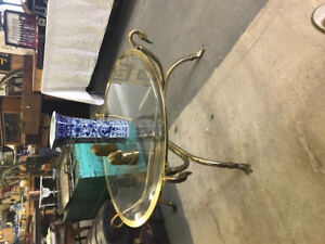 Round Brass Duck foot coffee table