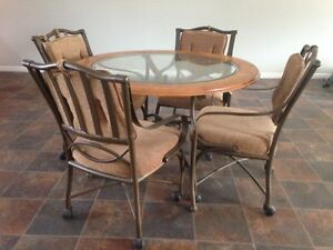 Glass Table top and 4 swivel chairs