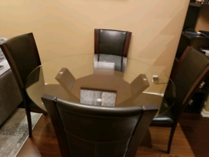 Glass dinning table (table only) perfect condition