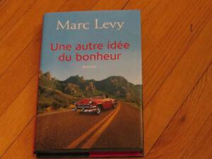 MARC  LÉVY  / UNE AUTRE IDÉE DU BONHEUR  / AUTEUR l