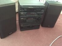 Aiwa music system with speakers
