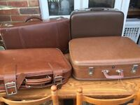 Job lot of vintage suitcases and holdall bags