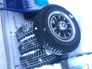 Tire and rims off of 1990 buick centry custom