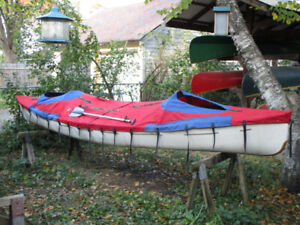 Tripping Royalex canoe with spray cover