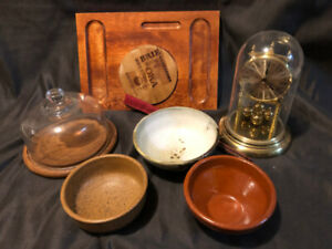 Wooden cheese plates, pottery bowls and clock