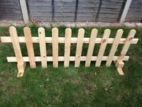 Wooden picket fence panel freestanding