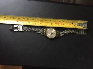 Swatch new battery and this is a rare one 60$ London Ontario image 2