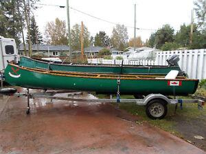 18 ft Chestnut freighter canoe,15hp outboard, galvanized trailer