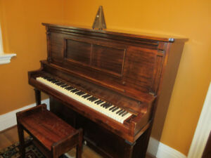 Ennis and Co. upright piano with bench and metronome