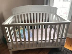 White crib complete with mattress and crib sheets