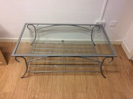 Metal framed glass topped table