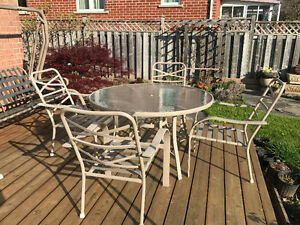 Must sell - Patio table with 4 matching chairs