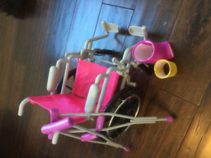 Doll wheelchair with crutches and leg cast