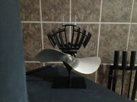 heat powered wood stove fan new price 120$ like new hardly used