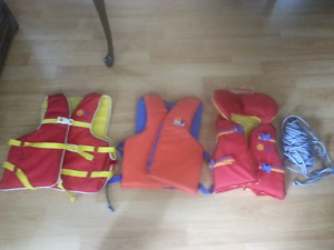 BuoyOBoy life vests. 2 adult X-large and one youth (18-41 kg)