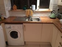 Kitchen units with gas cooker gas hob with sink and taps