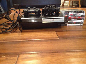 PlayStation 3 with controllers and games
