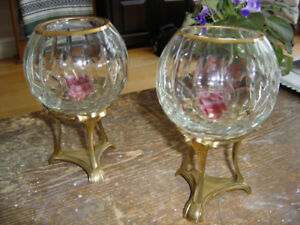 Two matching candle holders with brass stand base