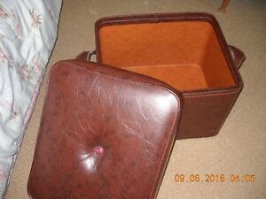 For sale Brown leather Footstool with storage compartment..