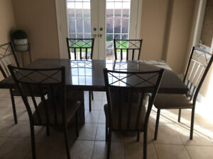 Grey/violet granite table with 8 chairs