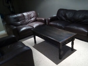 Three piece couch set and center table