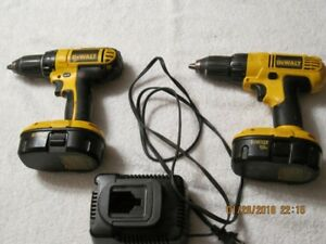 two 18 v dewalt drills with batteries and charger