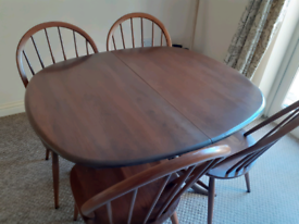 Ercol extending dining table with 4 chairs