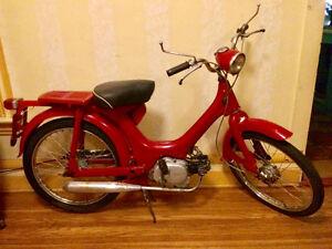 Little red 1970 Honda Moped for sale