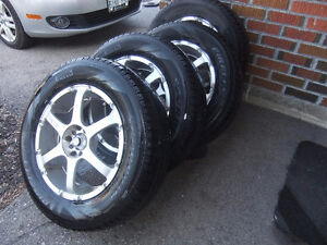 set of 4 enkei 235/65/R17 rims and pirelli scorpion tires
