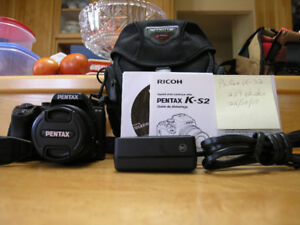 "PENTAX k-S2 & 18-50mm.= 239 ""clicks"". $425.00"