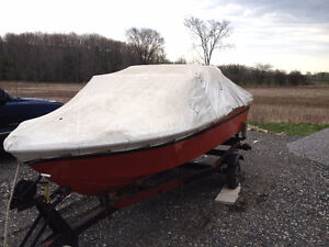 15 ft ss grew boat and trailer, great shape