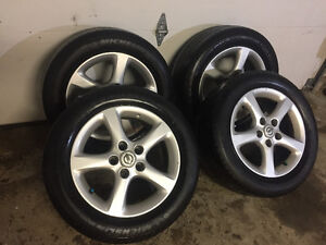 215/55/16 michelin. Nissan alloys