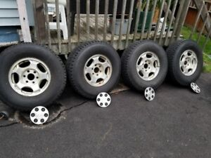 LT265/75R16 Firestone Winterforce studded snow tires and rims