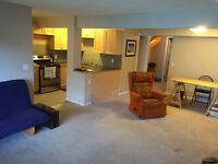 Airdrie's Nicest Walk Out Basement suite includes Garage Parking