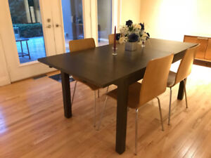 IKEA Bjursta extendable table and four CB2 wooden chairs