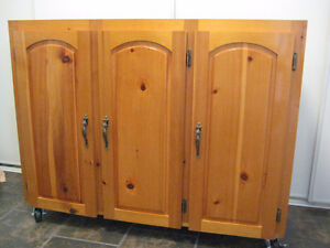SOLID PINE CUPBOARD WITH HEAVY DUTY CASTERS