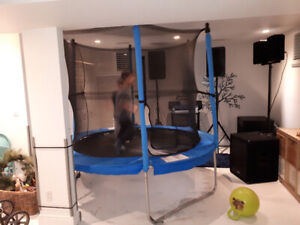 8 foot Trampoline With Safety Net - in excellent condition.
