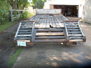 22 ft home built equipment trailer with beavertail ramps;