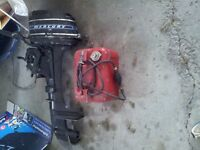 Outboard motor and gas tank