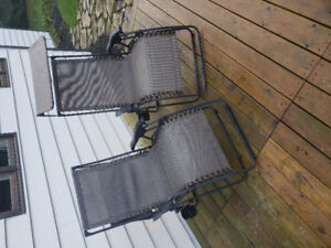 2 zero gravity chairs with awnings