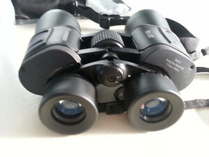 Bresser 10x50 binoculars, with caps, strap, and case
