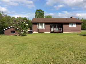 Bungalow With Attached Garage on 4 Acre Riverfront Property!