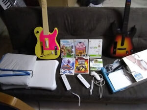 Wii console with Wii Fit Board, Dance Mat and 2 Guitars