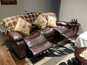 Need to relax? Check out this leather recliner sofa