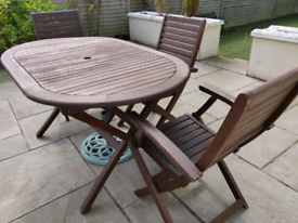 ***SOLD*** Teak garden table and three chairs