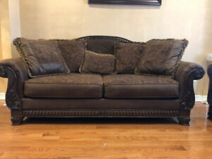 BRAND NEW ASHLEY sofa seat excellent condition $600