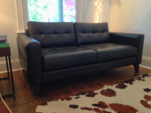 Top quality Leather couch with cover protector. 70x38. $1000
